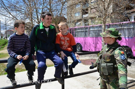 Three boys and a KFOR peacekeeper in Mitrovica, Northern Kosovo.